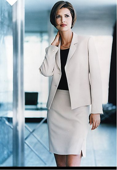 Woman wearing a beige skirt suit in the office, 1999