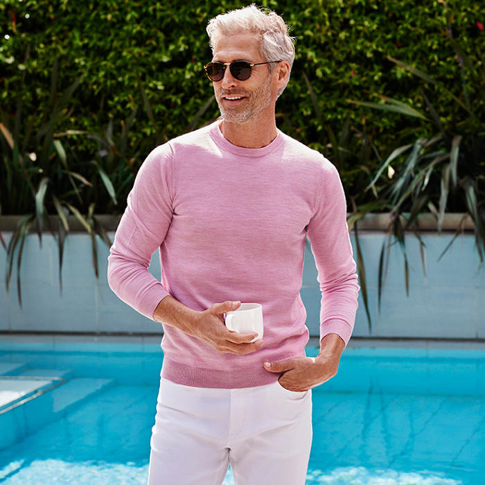 Man wearing pale pink jumper made from merino wool