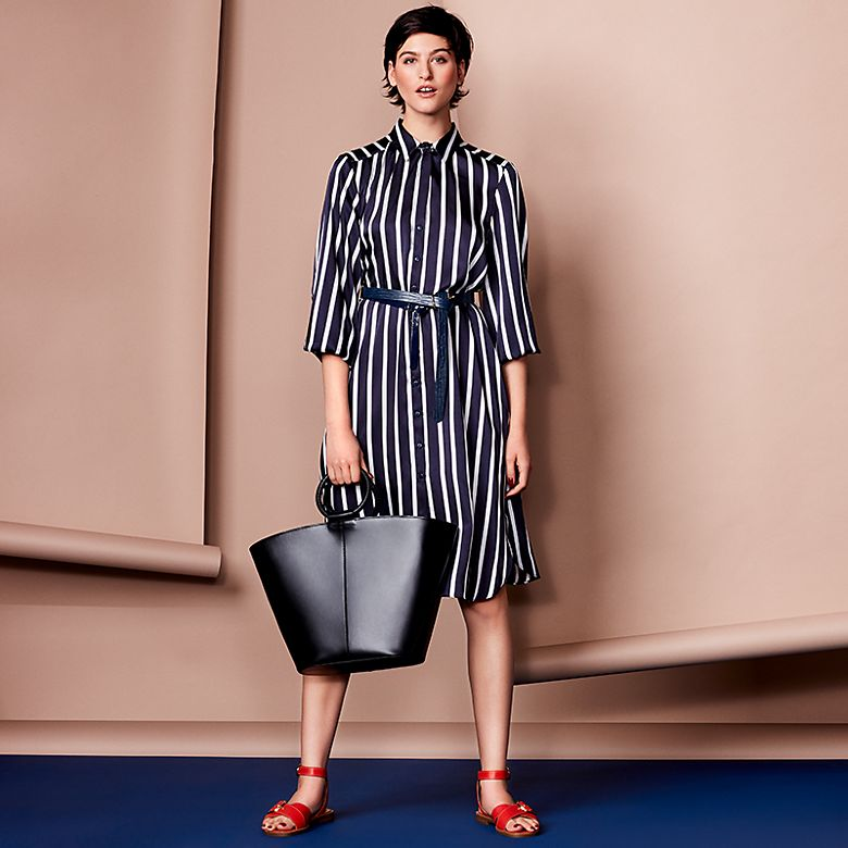 Models wears blue stripe shirt dress