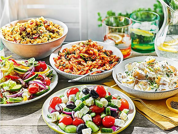 A selection of salads and sides on an outdoor table