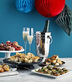 Plates of nibbles and champagne