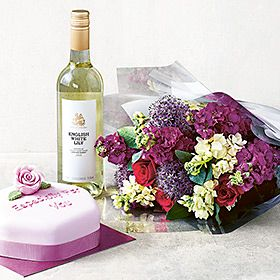 Bouquet of tulips, sparkling wine and chocolates