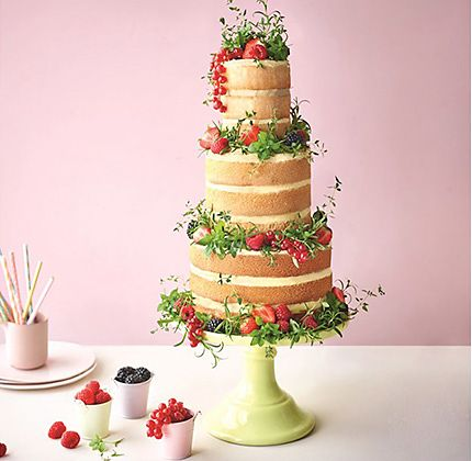 Naked cake decorated with fresh fruit and flowers