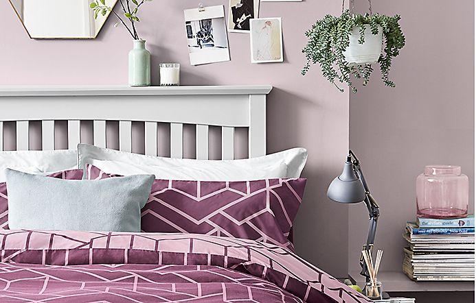 Pink geometric-patterned bedding on Hastings Grey bed