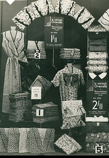 Women's workwear overalls displayed in an M&S shop window, 1930s