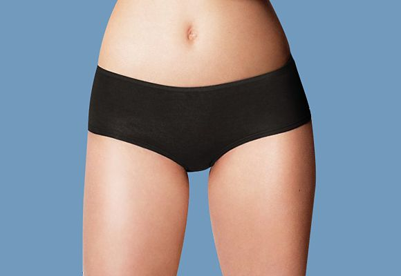 Woman wearing black low-rise knickers
