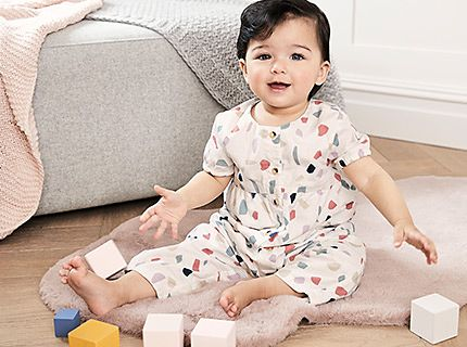 Baby girl wearing an M&S baby outfit