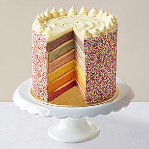 Rainbow layers cake on stand