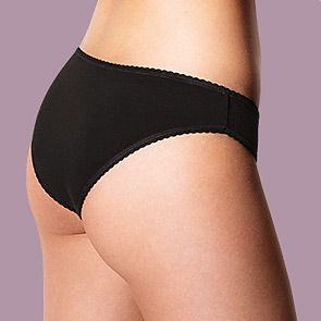 Woman wearing black Brazilian knickers
