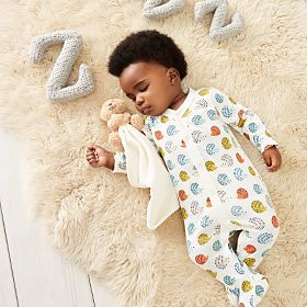 Baby girl asleep in baby grow