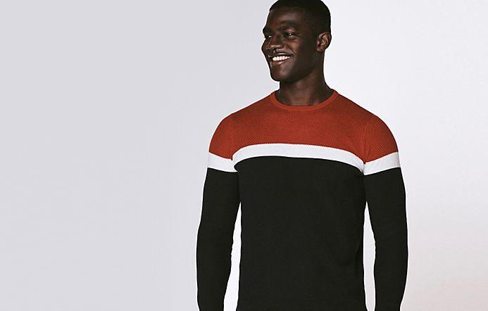 1ac02ab4180 Man wearing colour-block jumper