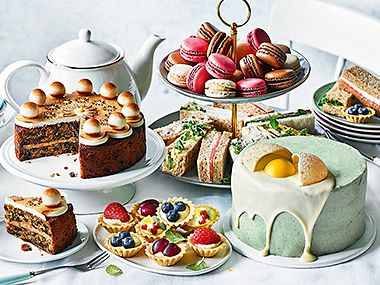 Selection of afternoon tea cakes and sandwiches and Easter cakes