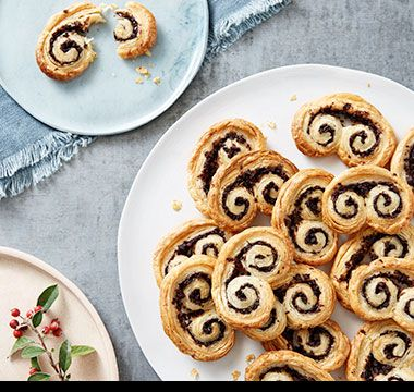 Puff-pastry palmiers filled with tapenade