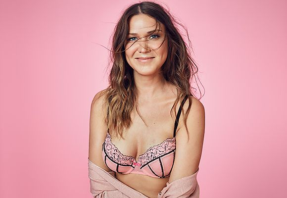 Women in pink and black bra
