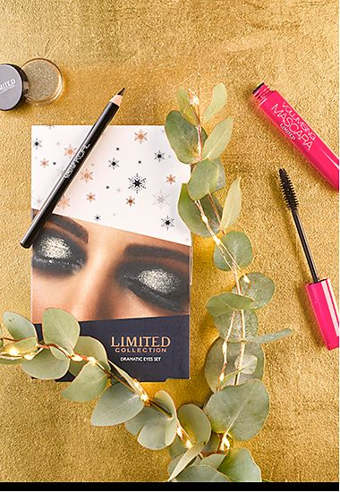 Limited Dramatic Eyes make-up gift against a festive gold background
