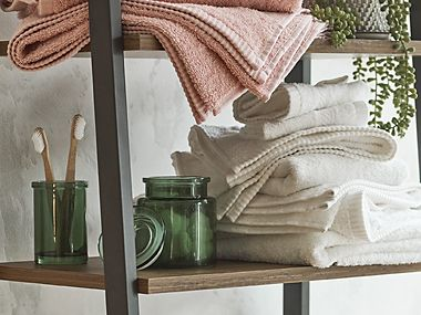 Towels and bathroom accessories on shelving