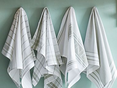 Tea towels hanging on hooks