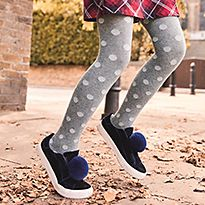 Girl wearing a printed grey tights and blue shoes