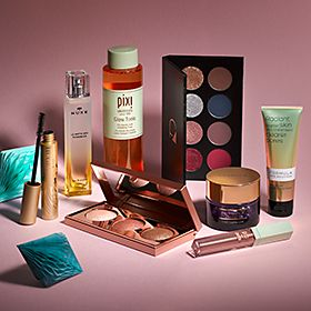 Collection of beauty items including make-up and perfume