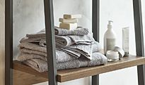Towels stacked on shelving