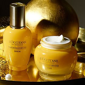 L'Occitane skin care gifts on a gold tray