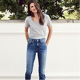 Model wears denim shirt and jeans