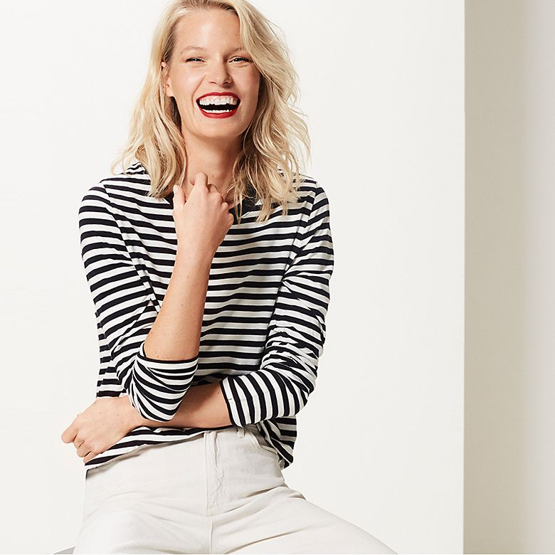 Model wears Breton striped top