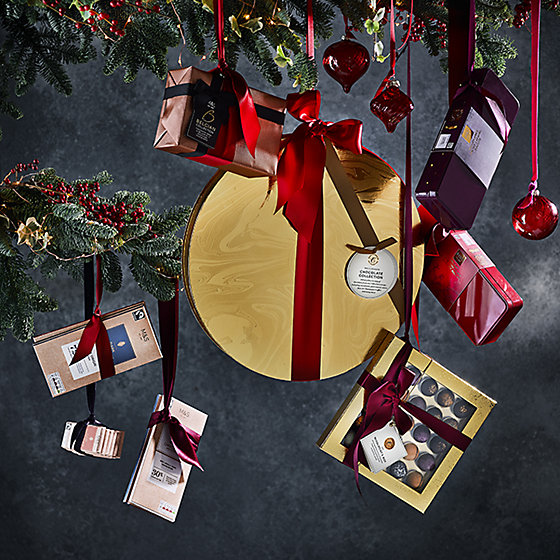 selection of chocolate treats hanging from a christmas tree