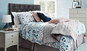 Patterned bedding on a divan bed