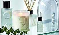 Scented candles and reed diffusers in a bathroom
