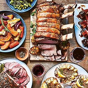 Roast pork with sides and wine