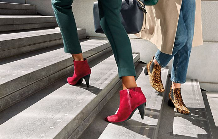Women walking on steps wearing red block-heel and leopard-print Chelsea boots