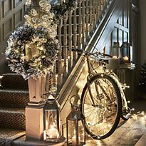 Festive hallway with lights, wreath, bike and lanterns
