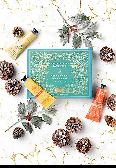 Crabtree & Evelyn hand cream set surrounded by Christmas foliage and pine cones