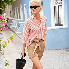 Woman in tan shorts and a striped shirt