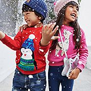 Kids wearing Christmas jumpers and winter accessories