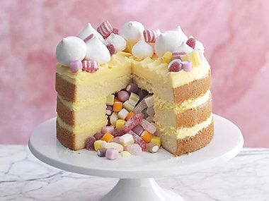 Naked cake covered with sweets