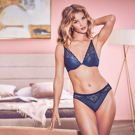 Rosie Huntington-Whiteley wearing a navy lace-embroidered padded plunge bra and matching knickers from the Rosie for Autograph range