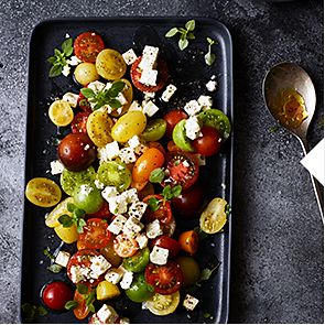 A tray of summer tomato and basil salad