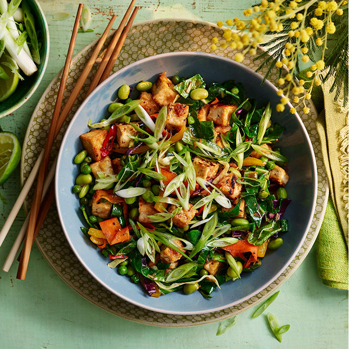 Warm noodle salad with crispy fiery tofu, high-protein pea noodles and lime
